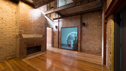 Interior of Director's Residence with audiovisual display. Image: Stuart Hay, ANU.