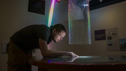 Dr Brad Tucker looking at sunspots: Image: Stuart Hay, ANU.